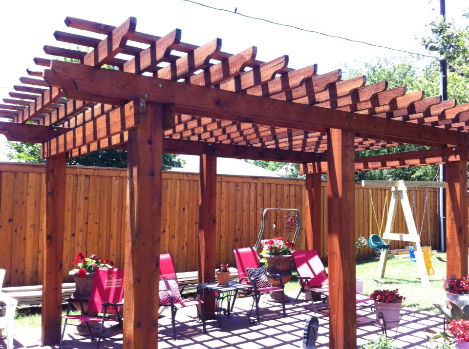 We also build Pergolas. This is a 14x20 stained dark cedar. This Is a one day build.