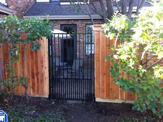 Ortamental iron gate with Doggie bars.