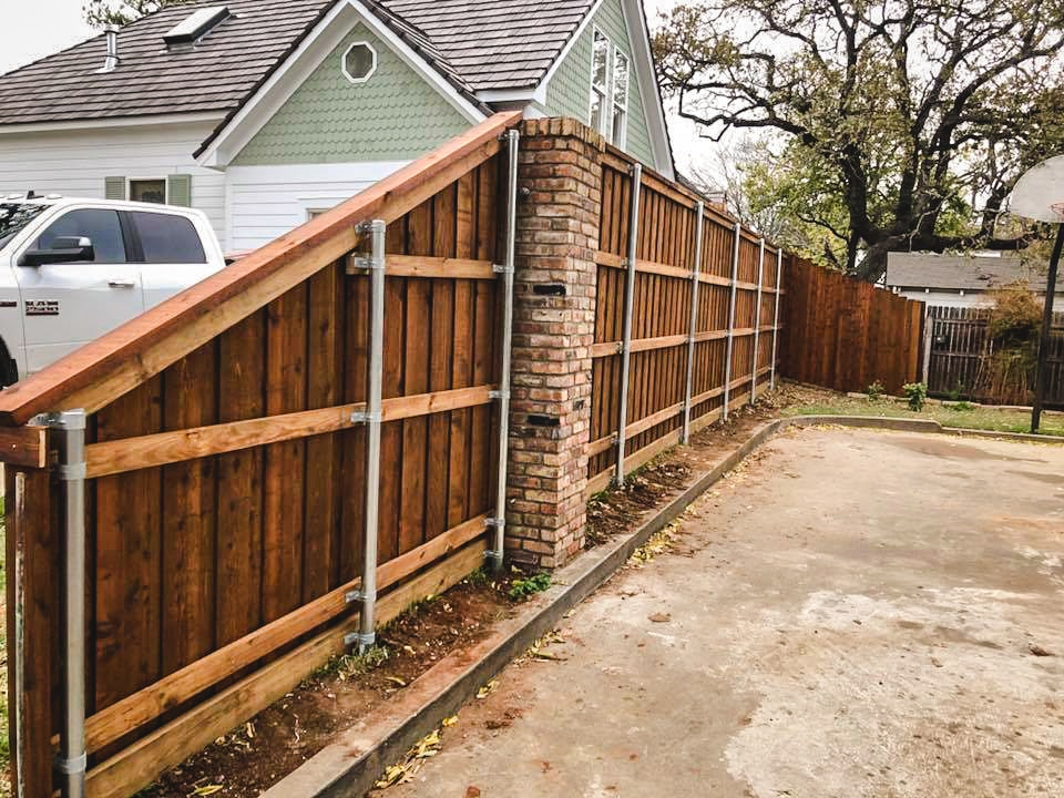 8- foot tall cedar pre-stained fence.
