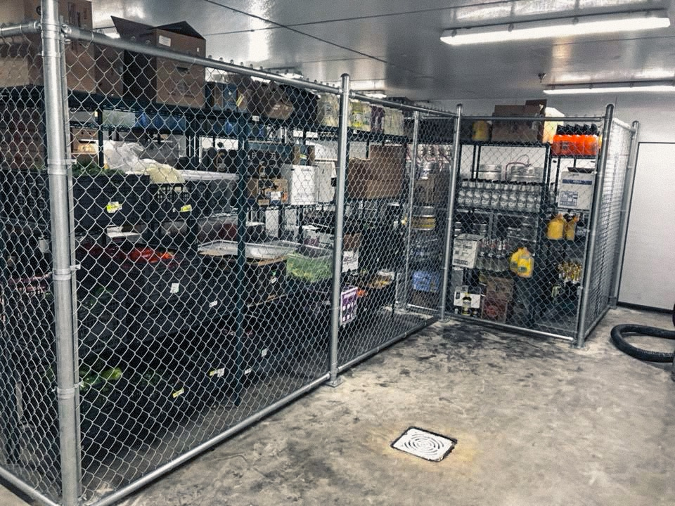 Chain link security cage for a commercial warehouse, securing inventory